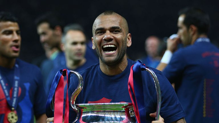 Alves celebrates with the Champions League trophy in 2015