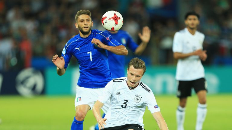 Yannick Gerhardt of Germany challenges for the ball