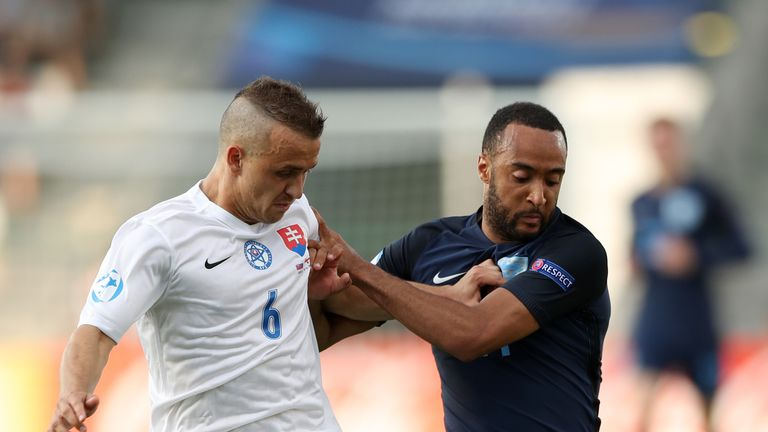 Nathan Redmond battles for possession