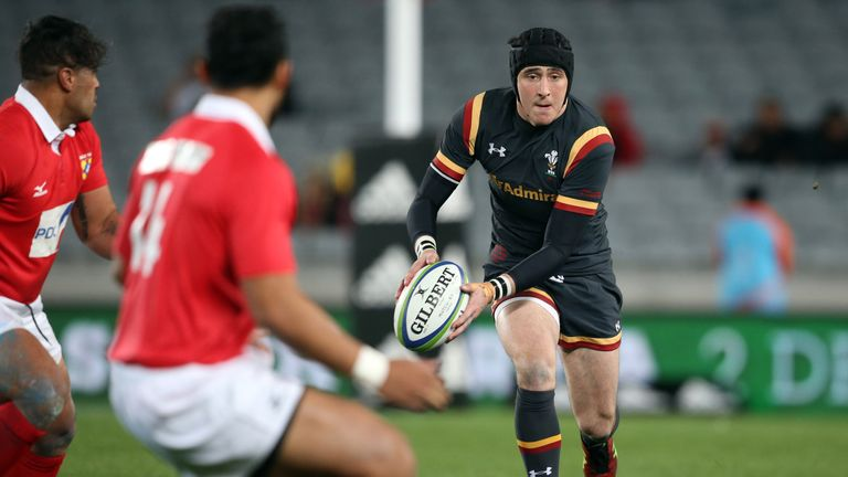 Sam Davies of Wales runs the ball against Tonga