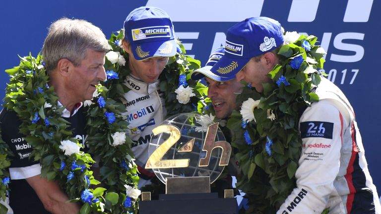 Porsche's Timo Bernhard, Earl Bamber and  Brendon Hartley celebrate on the podium
