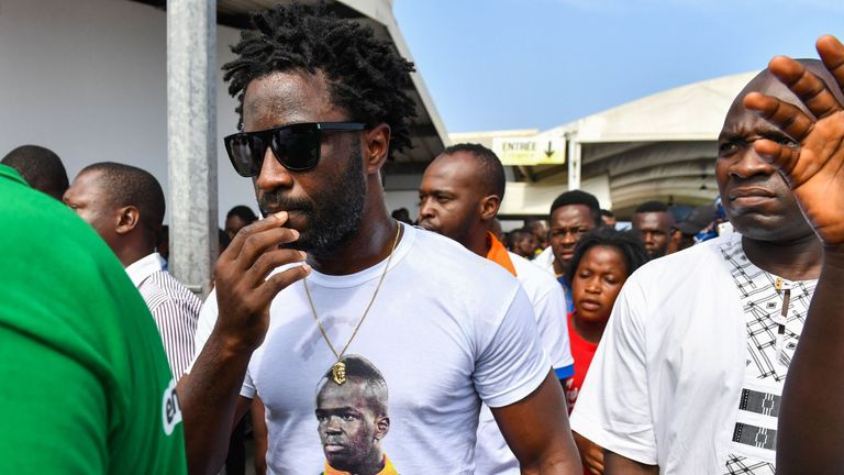 Ivory Coast forward Wilfried Bony attends the arrival of the casket