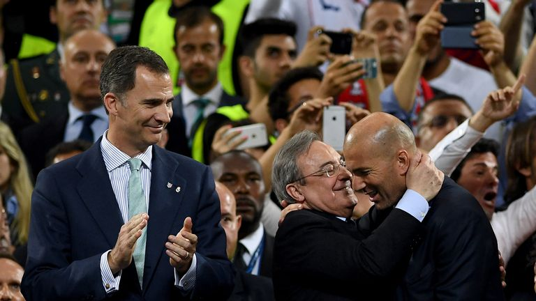 Zinedine Zidane is congratulated by Real Madrid president Florentino Perez after their Champions League win in Cardiff