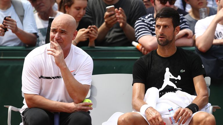 Novak Djokovic in discussion with coach Andre Agassi during the 2017 French Open at Roland Garros