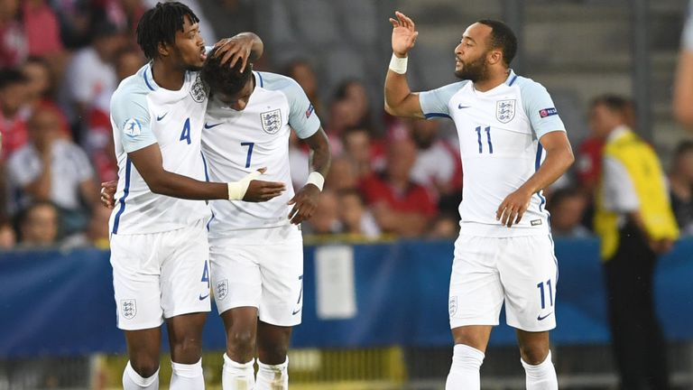 England's midfielder Demaray Grey (C) celebrate scoring the opening goal w