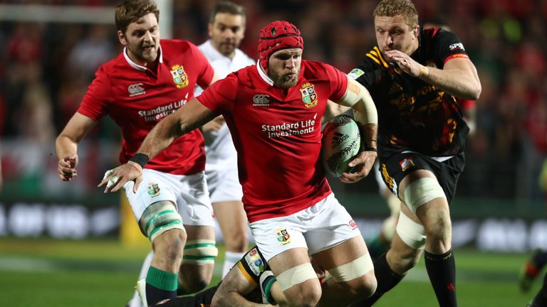 James Haskell of the Lions is tackled by Chiefs' Finlay Christie