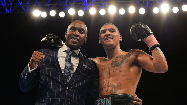 Conor Benn celebrates with his father Nigel Benn after beating Luke Keleher