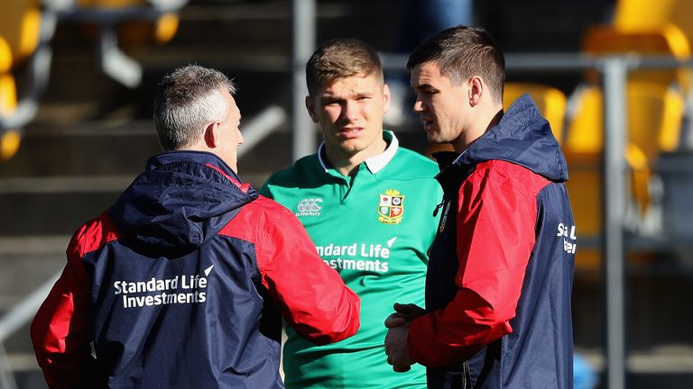 Lions backs coach Rob Howley (L) talks to Owen Farrell and Johnny Sexton during a British & Irish Lions training session