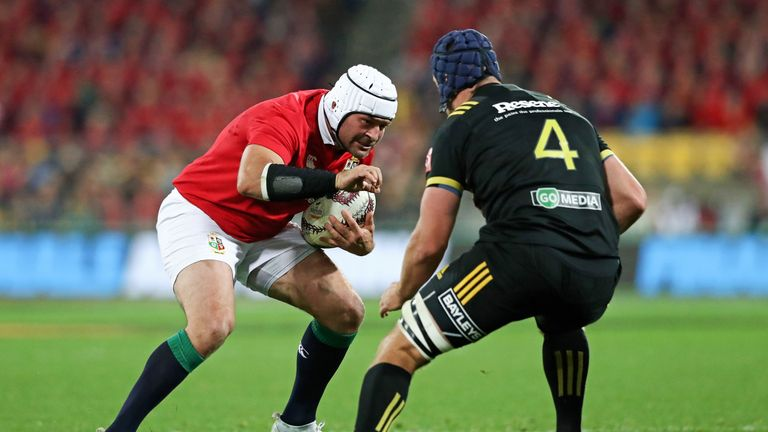 Rory Best is confronted by Mark Abbott of the Hurricanes during the 2017 British & Irish Lions tour match