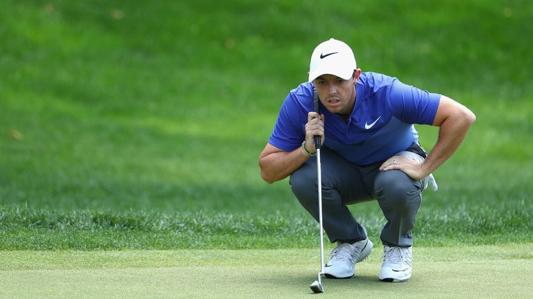 Rory McIlroy of Northern Ireland lines up a putt on the 18th green during the final round of the Travelers Championship