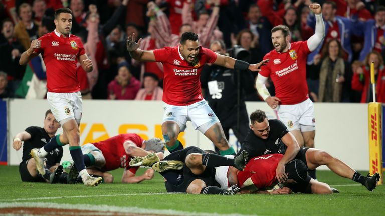 British and Irish Lions Sean O'Brien (R) dives over to score a try during their Test match between New Zealand
