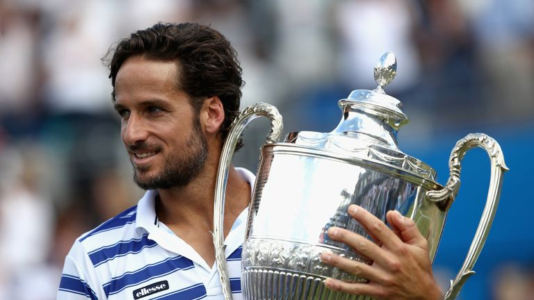 Feliciano Lopez of Spain celebrates with the winners trophy following victory in the mens singles final against Marin Cilic