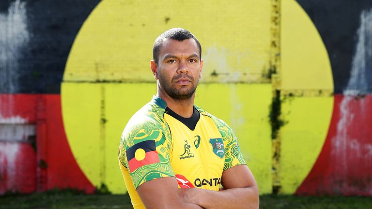 Beale models the specially designed Australian jersey to honour the contribution of indigenous Wallabies