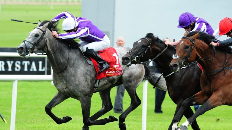 Capri ridden by Seamie Heffernan (left) wins the Irish Derby