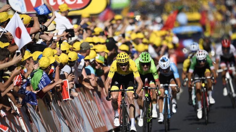 Chris Froome sprints to the line ahead of his rivals after a dramatic stage 15