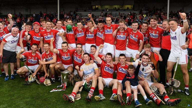 Cork celebrate with the trophy after beating Clare in the Munster hurling final