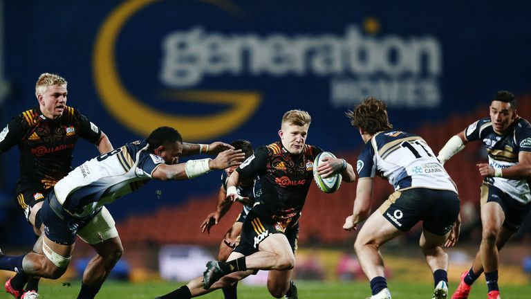 Damian McKenzie on the attack against the Brumbies