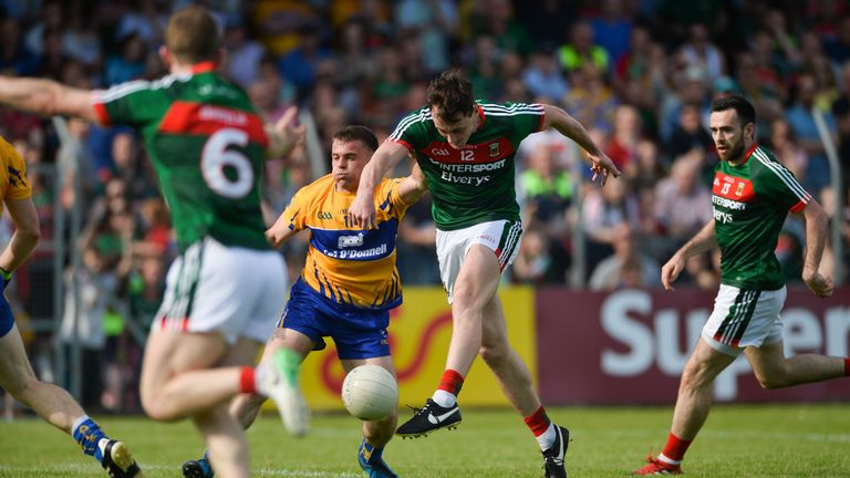 Diarmuid O'Connor of Mayo shoots to score his side's second goal despite the efforts of Sean Collins of Clare