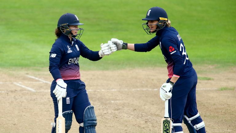 England's Sarah Taylor and Tammy Beaumont celebrate during their World Cup match against West Indies