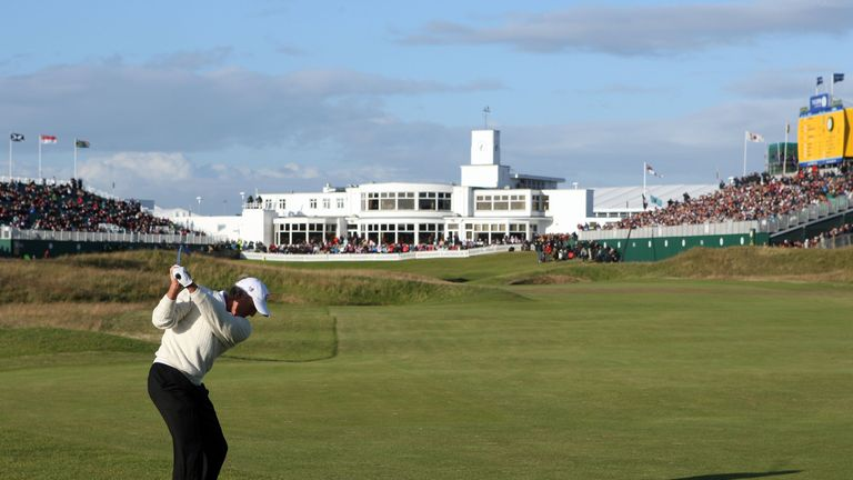 Greg Norman plays his approach shot to the 18th green at Royal Birkdale during the third round of the 137th Open