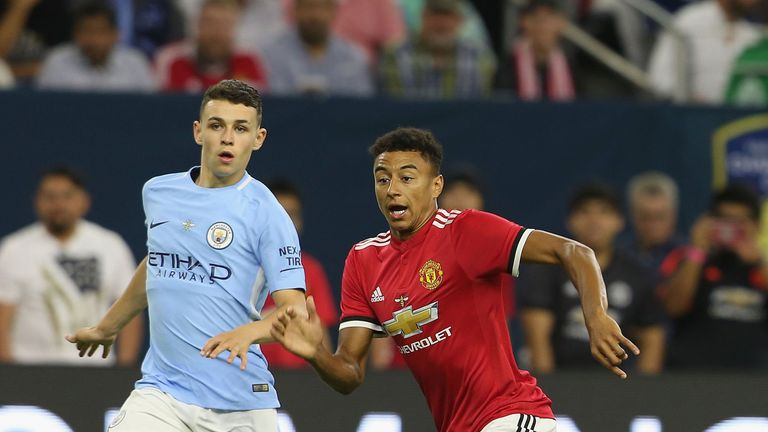 Jesse Lingard comes up against City's Phil Foden during the game in Houston