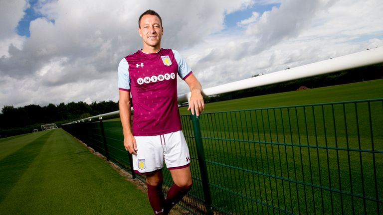 Terry poses at Villa's training ground after signing a one-year deal with the Championship club