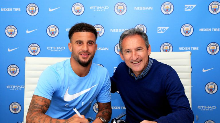 Kyle Walker pictured with Manchester City director of football Txiki Begiristain after signing a five-year contract with the club on Friday