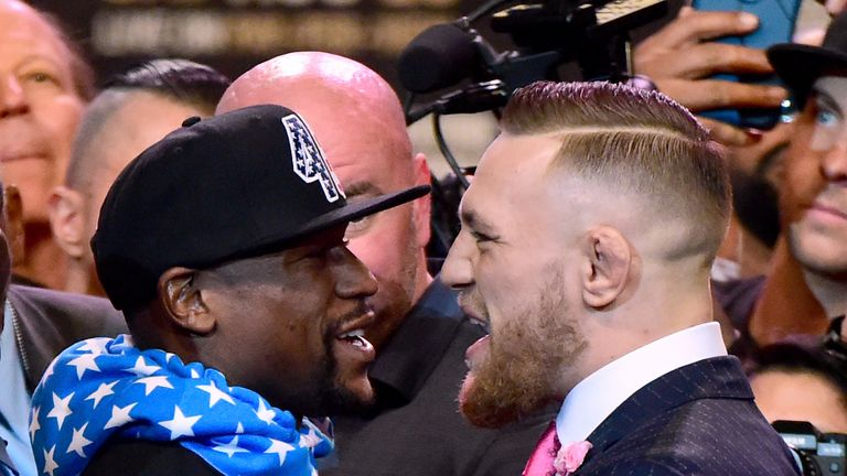 Mayweather and McGregor stand face to face during their first media conference