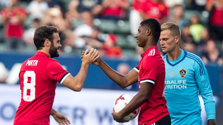 Marcus Rashford (right) celebrates with team-mate Juan Mata