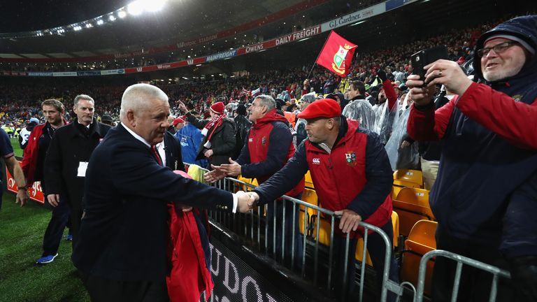 Warren Gatland shakes hands with Lions fans after the second Test