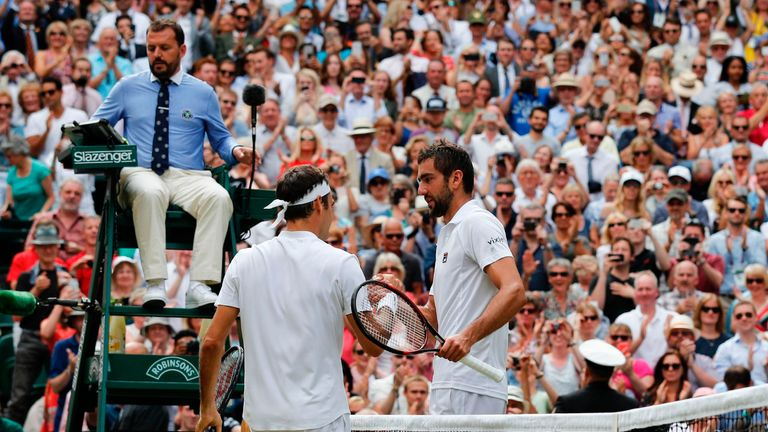 Federer shakes hands with Cilic after winning the final