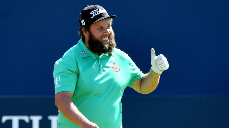 Andrew Johnston of England gives a thumbs up to the crowd on the 1st hole during a practice round prior to the 146th Open Championship