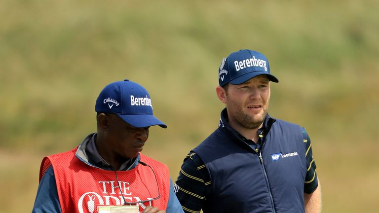 SOUTHPORT, ENGLAND - JULY 22:  Branden Grace of South Africa with his caddie Zak Rasego on the 16th fairway during the third round of the 146th Open Champi