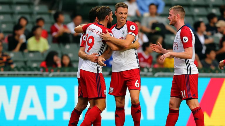 Jay Rodriguez of West Brom is congratulated by Jonny Evans after he scored against Leicester City during the Premier League Asia Trophy match in Hong Kong