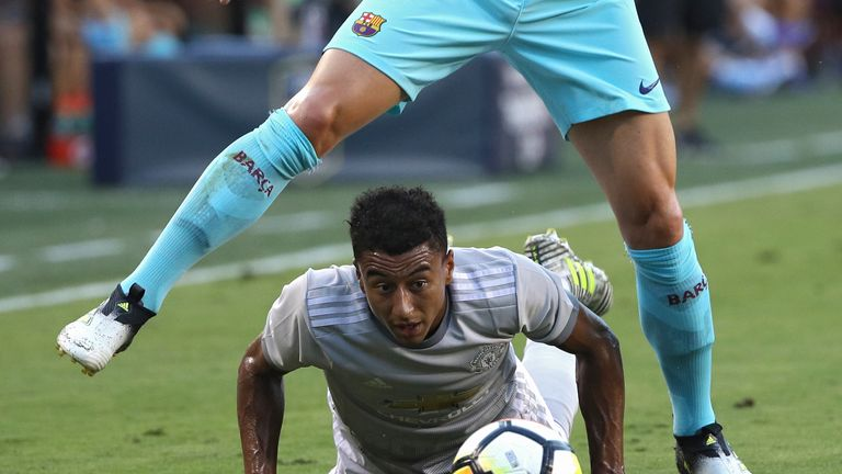 LANDOVER, MD - JULY 26: Jesse Lingard #14 of Manchester United (bottom) and Ivan Rakitic #4 of Barcelona battle for the ball in the first half during the I