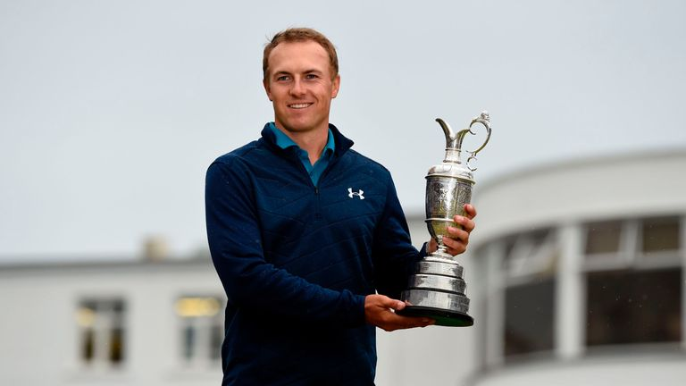 US golfer Jordan Spieth poses for pictures with the Claret Jug, the trophy for the Champion golfer of the year, in front of the Art-Deco-style clubhouse, a