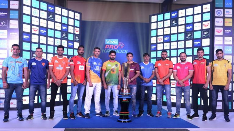 Indian Kabaddi team captains pose with the trophy of the fifth edition Pro Kabaddi League 2017 in Hyderabad on July 27, 2017.