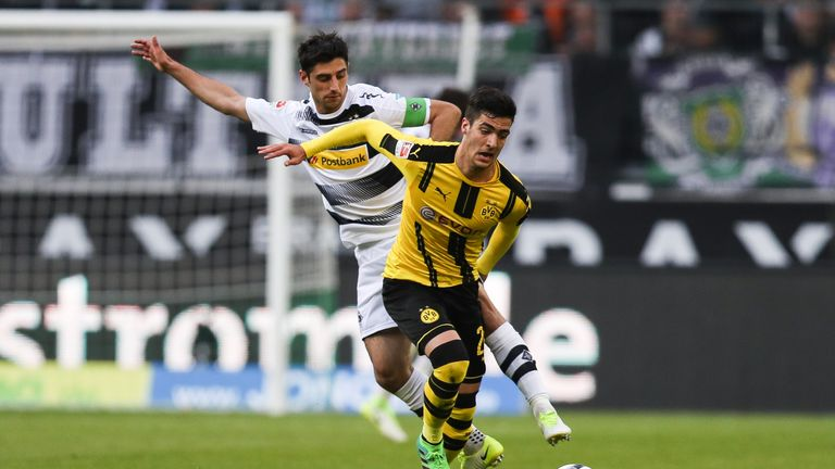 MOENCHENGLADBACH, GERMANY - APRIL 22: Lars Stindl of Moenchengladbach and Mikel Merino Zazon of Dortmund battle for the ball during the Bundesliga match be