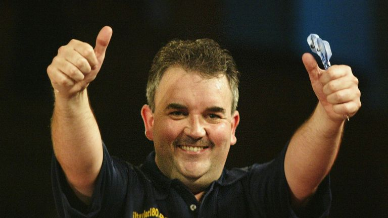 Phil Taylor of England celebrates winning his match against Kevin Painter of England at the World Matchplay
