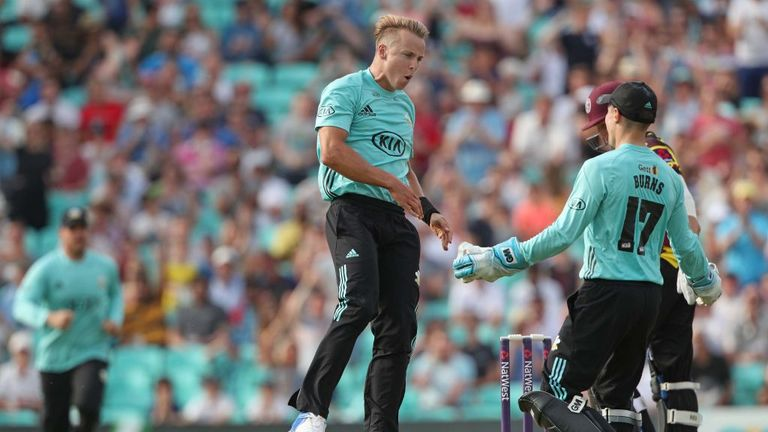 LONDON, ENGLAND - JULY 09: Bowler Tom Curran celebrates with wicket keeper Rory Burns after Surrey win a last ball thriller during the NatWest T20 Blast ma