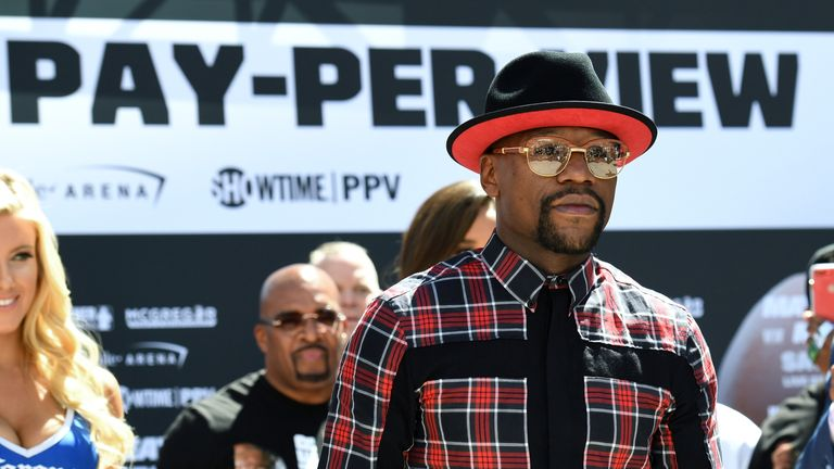 Floyd Mayweather's team were met by Conor McGregor and his at Grand Arrivals.