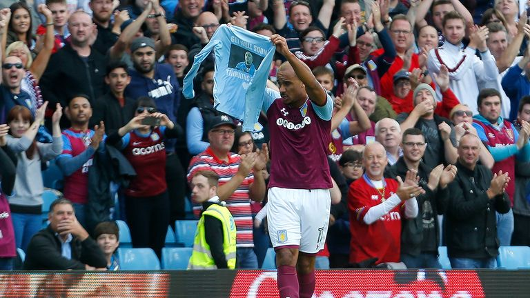 Gabby Agbonlahor celebrates his goal by holding up a t-shirt in support of Wolves player Carl Ikeme