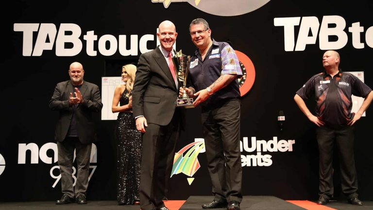 Gary Anderson receives the Perth Masters trophy after victory over Raymond van Barneveld