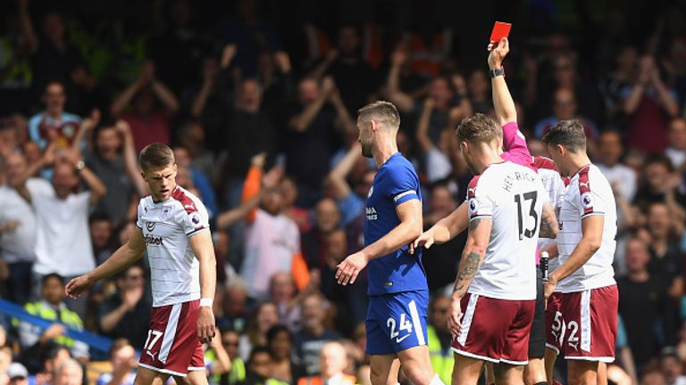 Gary Cahill is sent off by referee Craig Pawson after a high challenge on Steven Defour