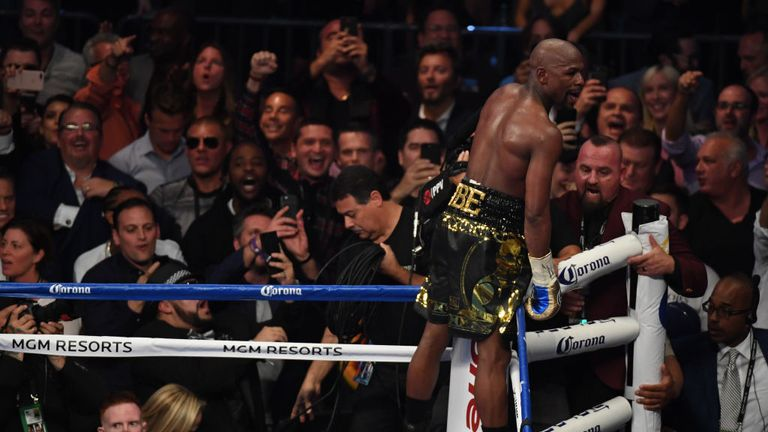 Mayweather Jr. celebrates his TKO of McGregor