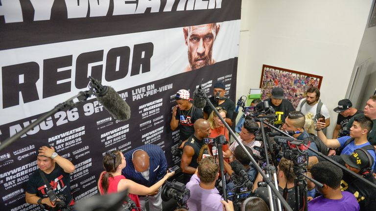 Floyd Mayweather is mobbed by the media in his workout ahead of the huge event