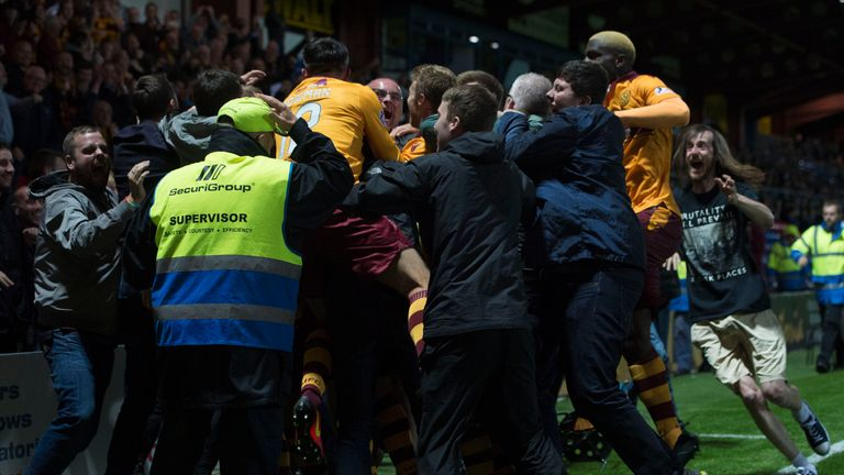 Joy unconfined in  Dingwall as Motherwell players - and fans - celebrate Ross MacLean's winner