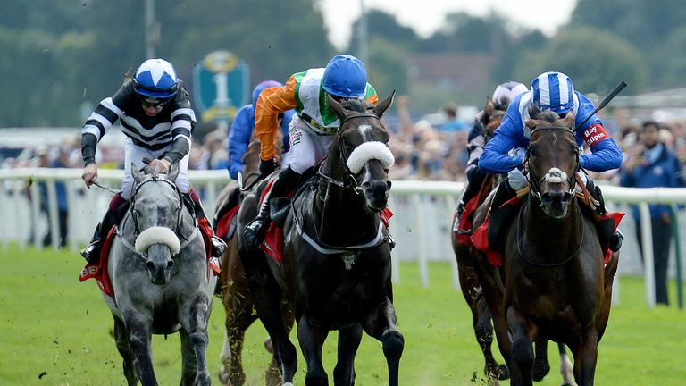 Mustashry ridden by Jim Crowley (right) wins the Betfred Mobile Strensall Stakes