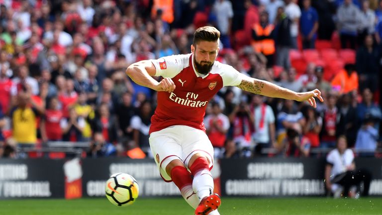 Olivier Giroud converts the decisive spot-kick at Wembley