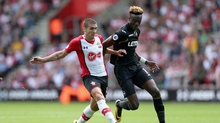 Oriol Romeu of Southampton challenges Swansea's Tammy Abraham